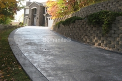 The owners of this private residence worked with Bomanite Licensee, Bulach Custom Rock to create a beautiful custom design for their concrete driveway and chose French Gray Bomanite Integral color with Bomanite Natural Gray Color Hardener for the body of the driveway and Bomanite Cobblestone Gray for the colored bands around the perimeter of the driveway.