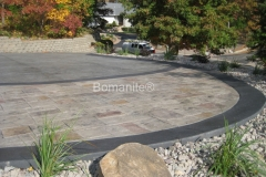 Bulach Custom Rock expertly installed this decorative concrete driveway and landing area using Bomanite Bomacron patterns and Bomanite Integral colors, creating the perfect interplay of color and texture to complement the exterior of this home.