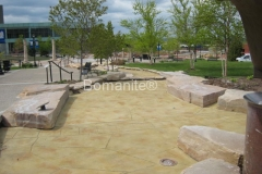 Bomanite Imprint Systems with Bomacron Textured Pattern Imprinted Concrete using Stamped Waterway at Nicollet Commons.