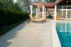 Bomanite Imprint Systems with Bomacron Textured Pattern Imprinted Concrete on a pool deck at a private residence.